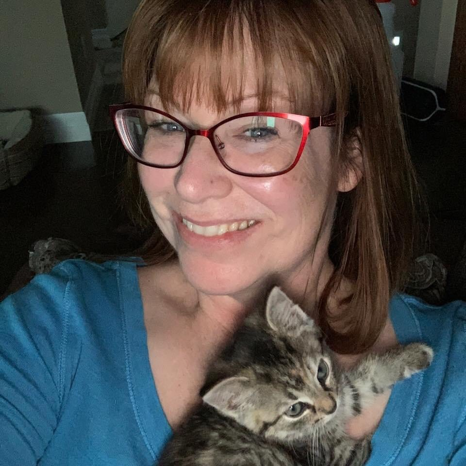 Carrie and one of her kitten fosters